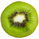 Kiwi slice. Cross-section of a kiwi isolated on white background Royalty Free Stock Photo