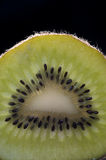 Kiwi Slice on Black Background stock images