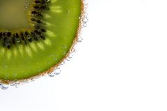 Kiwi slice with bubbles Stock Image