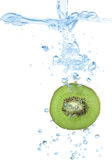 Kiwi slice splash in water Royalty Free Stock Photo