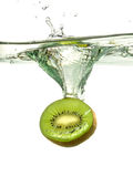 Kiwi Slice Splashing Into Water Stock Image