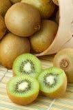 Kiwi Sliced And Whole Fruits, Basket Stock Photos