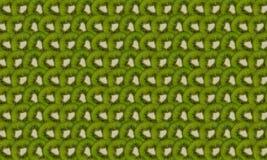 Kiwi slices. Thin kiwi slices folded into rows as background royalty free illustration