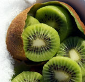 Kiwi Slices. The kiwi, originally from China, is a scrumptious fruit packed with vitamin C, potassium and fiber Royalty Free Stock Images