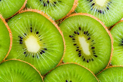 Kiwi slices background. Vibrant green kiwi slices wallpaper Royalty Free Stock Photography
