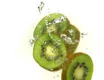 Kiwi slices and bubbles Royalty Free Stock Photos