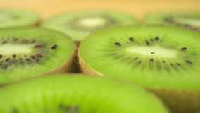 Kiwi slices close up dolly shot stock footage