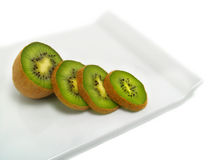 Kiwi slices on cutting board Royalty Free Stock Images