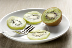Kiwi Slices on a Dish Stock Images