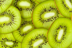 Kiwi slices. Lot of cross section slices of kiwi on a heap, top view Royalty Free Stock Images