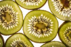 Kiwi Slices retroiluminado Fotografía de archivo libre de regalías