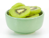 Kiwi slices in a small green bowl Royalty Free Stock Images
