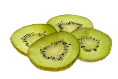 Kiwi slices. Some slices of kiwi on a with background stock photos