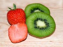 Kiwi slices and Strawberry slices Stock Photos