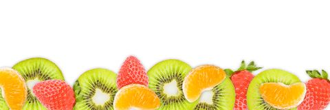 Kiwi slices, tangerines, strawberries on white panoramic backgroundr stock photography