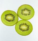 Kiwi. Slices of kiwi on a white background Stock Image