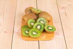 Kiwi slices on wooden background Stock Photo