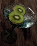 Kiwi slises. 2 slices of kiwi fruit in a glass Stock Photography