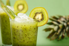 Kiwi smoothie. Fresh kiwi smoothie over green background Stock Image