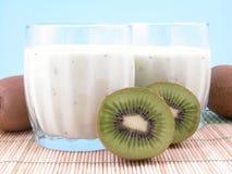 Kiwi smoothie. Tow glasses of kiwi smoothie and some fresh fruits royalty free stock photo