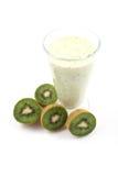 Kiwi smoothie. Glass of fresh kiwi smoothie and some fresh fruits isolated on white royalty free stock photography