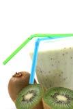 Kiwi smoothie. Glass of fresh kiwi smoothie and some fresh fruits isolated on white stock photography