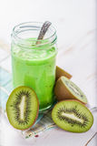 Kiwi smoothie in glass jar Stock Images