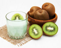 Kiwi smoothie in glass. On a old white wooden background Royalty Free Stock Photos