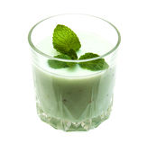 Kiwi smoothie in glass. On a white  background Royalty Free Stock Photography