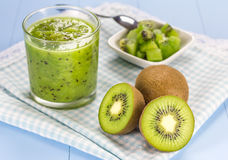 Kiwi smoothie in the glass. On the wooden table Stock Photos