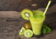 Kiwi yogurt smoothies juice,beverage healthy the taste yummy In glass drink episode morning on wood background. Kiwi smoothies colorful green juice beverage royalty free stock photography