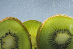 Kiwi and Soda. Kiwi fruit in soda water stock images
