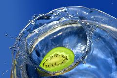Kiwi splash. Es into cold, fresh, water Stock Photo