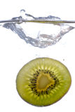 Kiwi splash. Photography of a kiwi slice splashing in water Royalty Free Stock Image