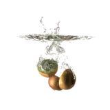 Kiwi splash on water, isolated. On white background. Use for fresh drinks advertising Royalty Free Stock Images
