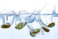 Kiwi splashing in water Stock Photo