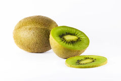 Kiwi split. A studio shot of a tropical kiwi fruit, on a white background. The image is taken with a high quality macro lens Stock Images