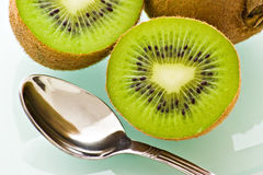 Kiwi and spoon Stock Images