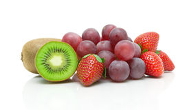 Kiwi, strawberries and grapes on a white background Royalty Free Stock Photos