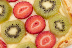 Kiwi and strawberry Stock Images