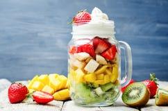 Kiwi strawberry banana mango salad with whipped cream Stock Photos