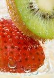 Kiwi Strawberry Fizz. A kiwi slice and strawberry in a drink Stock Photography