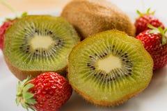Kiwi with strawberry on plate Stock Photo