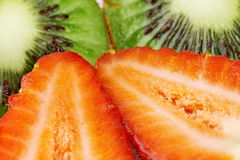 Kiwi and strawberry slices. Kiwi slices and strawberry slices extremely close up royalty free stock images