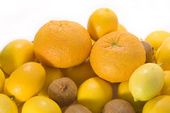 Kiwi, tangerines and lemons Royalty Free Stock Photos