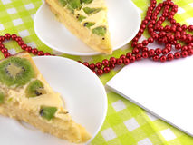Kiwi tasty cake close up at plate and red diamonds Royalty Free Stock Image