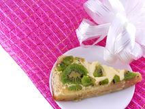 Kiwi tasty cake close up at plate with white bow Royalty Free Stock Photo