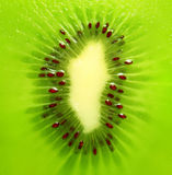 Kiwi texture. Close up of a kiwi fruit inside with seeds Stock Photos