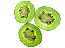Kiwi threesome. Three kiwi slices on white background Stock Images