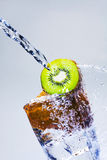 Kiwi with water Royalty Free Stock Image